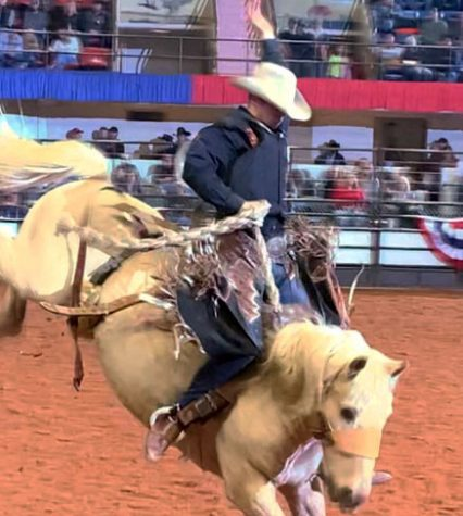Sophomore Greyson King competes in the bucking event at the Fort Worth Rodeo