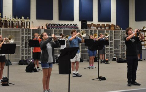 Part of the Bearcat Regiment practices in the band hall while maintaining social distancing Sept. 15.