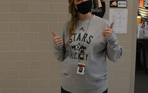 At the Daniel Ninth Grade Campus, English teacher Kendall Sifuentes wears a Dallas Stars sweatshirt Sept. 15 following the Stars victory in the Western Conference Finals.