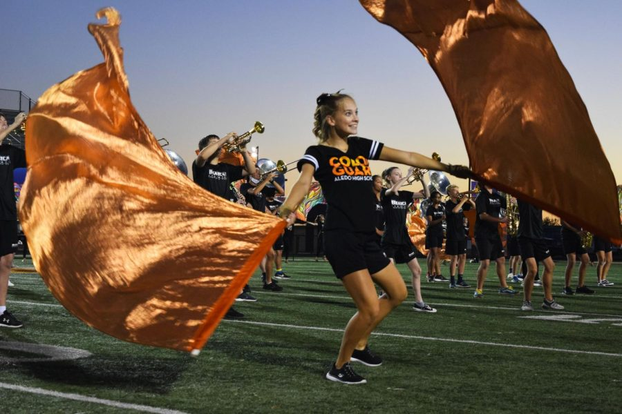 Junior Morgan Antone performs with the Bearcat Regiment and dance team in the sneak peak of the show: Sands of Time.