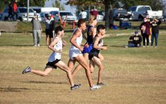 Junior Isaac Hernandez pushes to the lead pack at the start of the state cross country race in Old Settler's Park.