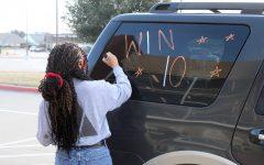Junior Jadyn Turner painting this year's slogan,