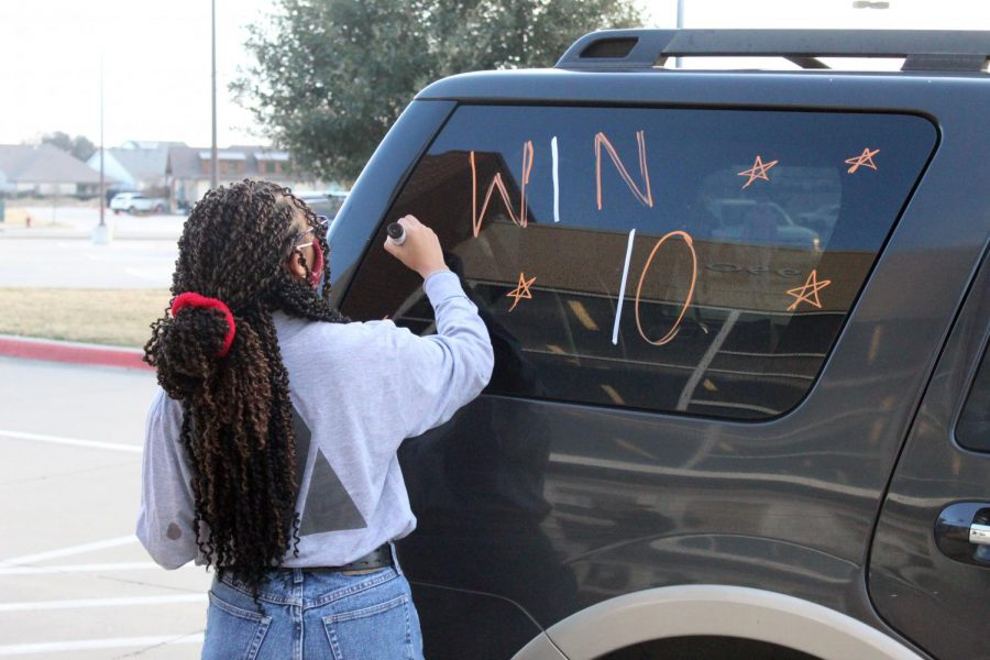 NHS and Cheerleaders Paint Cars For State