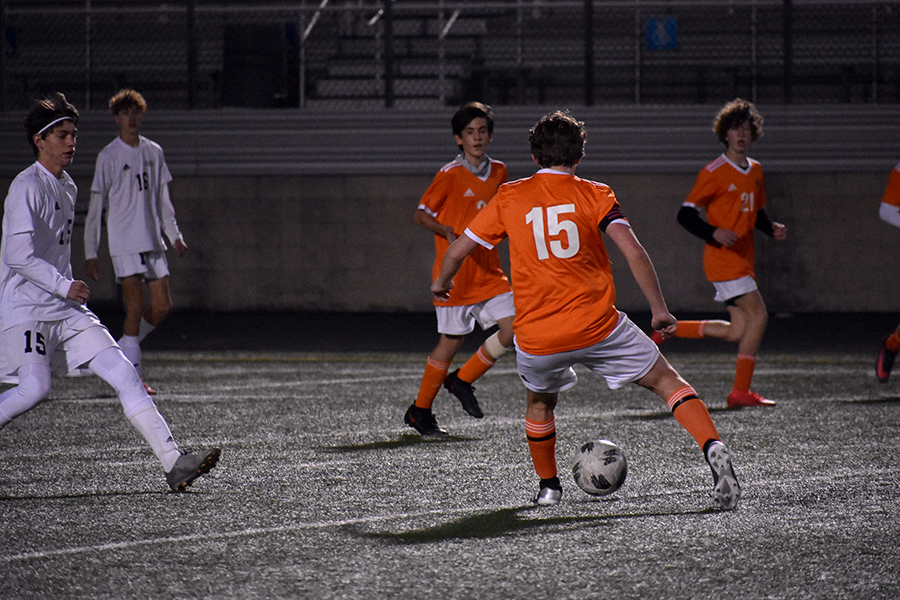 JV centerback plays a ball through the middle during Friday's game against Wichita Falls Rider.