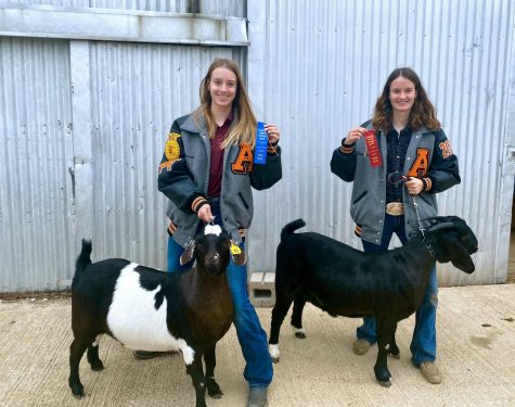 Rebecca Sullivan (left) poses with her prize-winning goat.