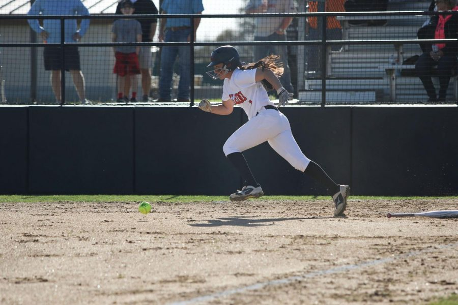 Junior shortstop, #1, Macy Graf runs to first base after recording a hit.