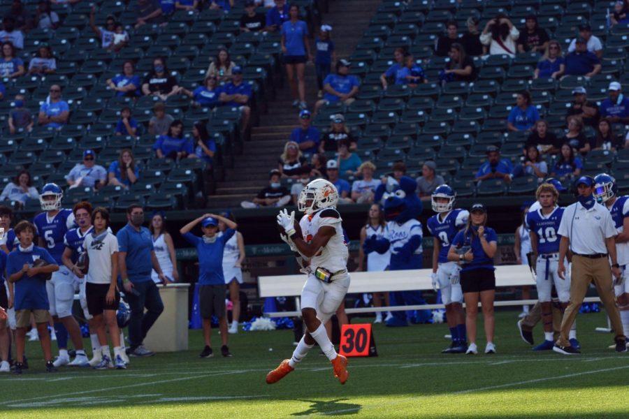 Senior wide receiver, #13, Logan Flinta makes a catch at the 30 yard line.