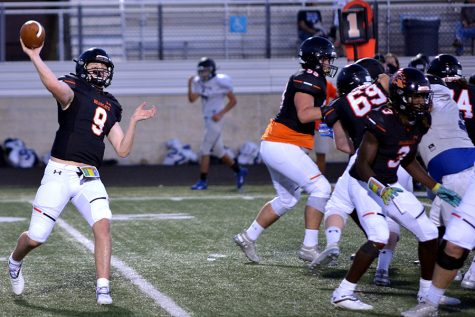 Sophomore quarterback Brant Hayden, #9, completes a pass in the North Forney scrimmage Sept. 17.