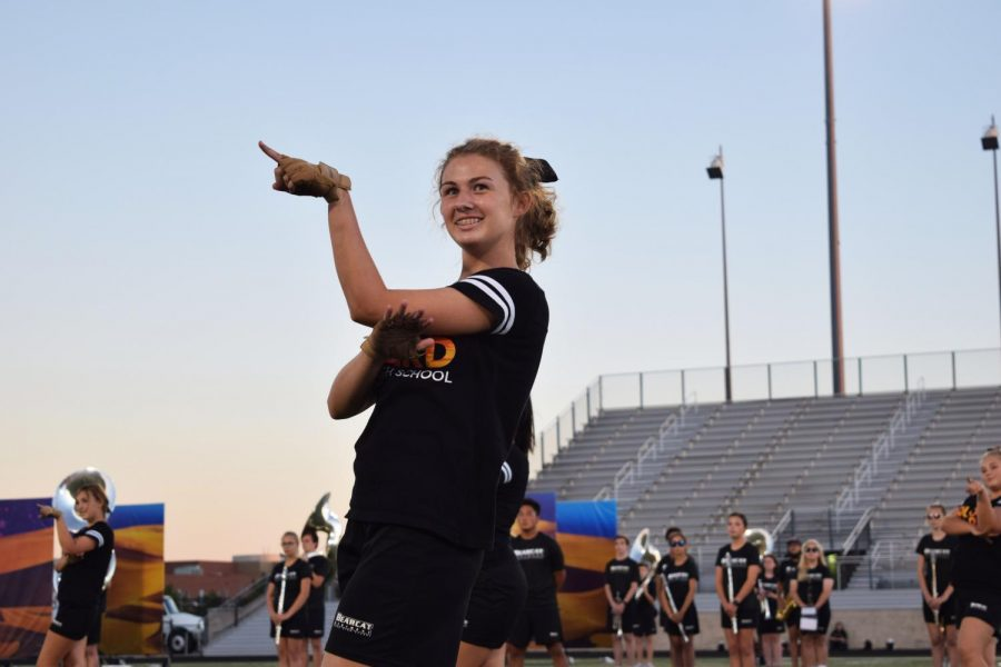 Junior Callie Green performs with the color guard.