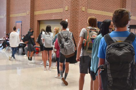 Students line up before school to get their flu shots.