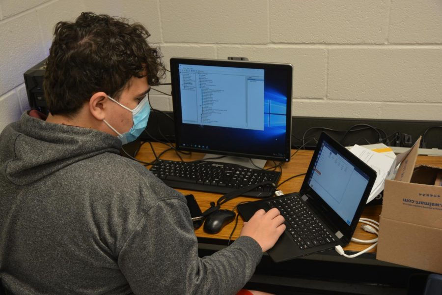 Sophomore Connor Cook working on a coding project for the Networking class on Nov. 17.