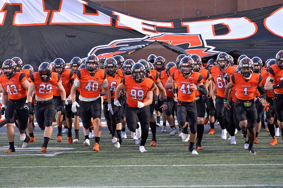 Varsity football team runs onto the field against Cedar Hill on Oct. 17.