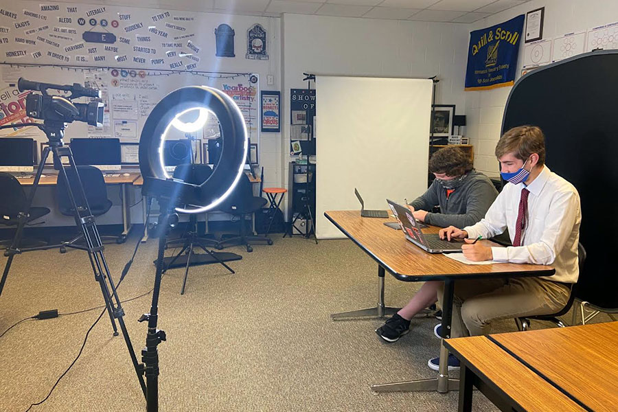 Senior reporter James Ward and sophomore reporter Payne Wellman record the first episode of the Bearcat Sports Network.
