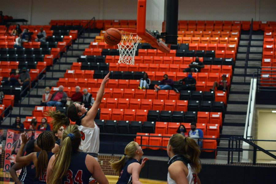 Sophomore center, #10, Claire Byars makes a layup against Northwest on Nov. 20.