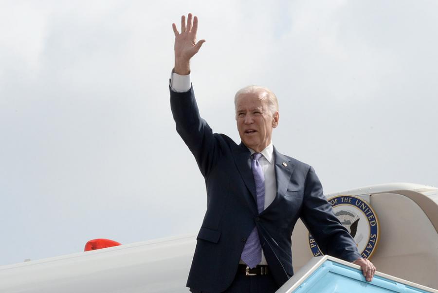 Joe Biden waves from the airplane.