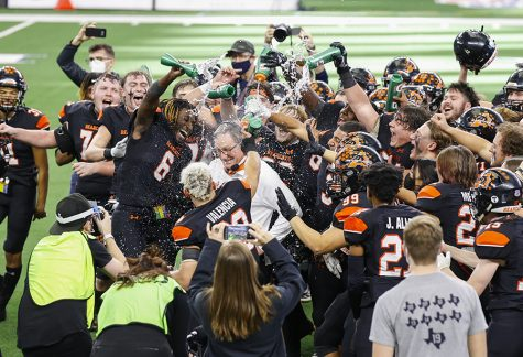 Aledo football players douse head coach Tim Buchanan in water after winning their 10th state championship title against Crosby on Jan. 15.