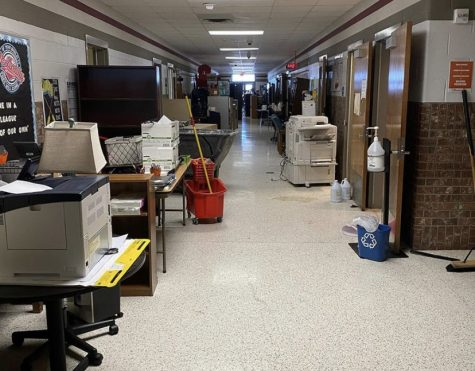 Furniture and equipment line the halls of McAnally Intermediate following flooding caused by burst pipes during last week