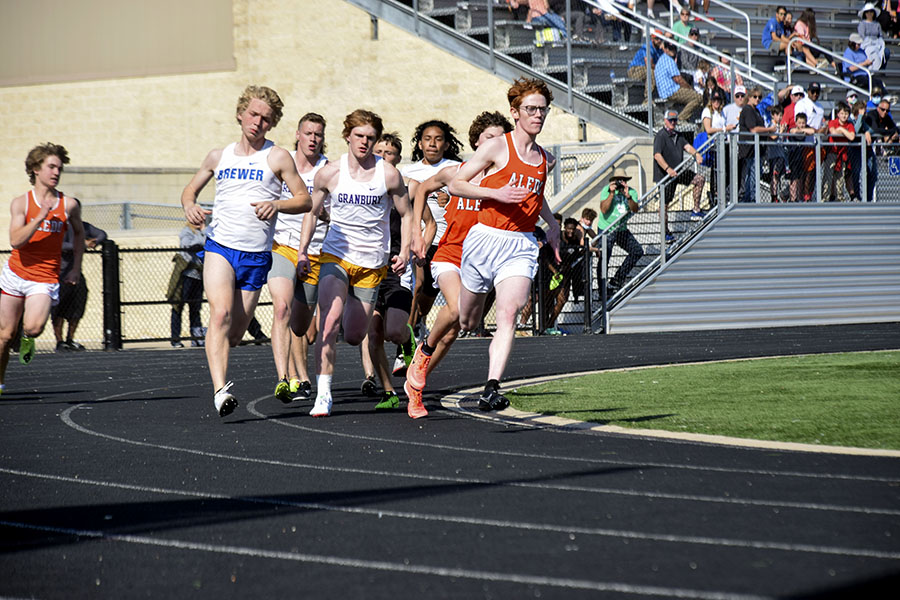 Junior Maverick Savage leads the pack at the beginning of the second lap of the 800.