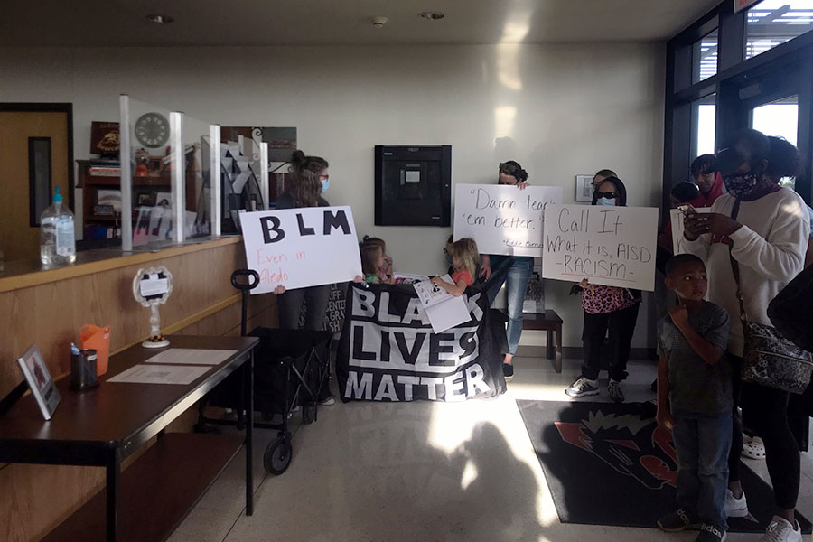 Community members wait for the board meeting to begin.